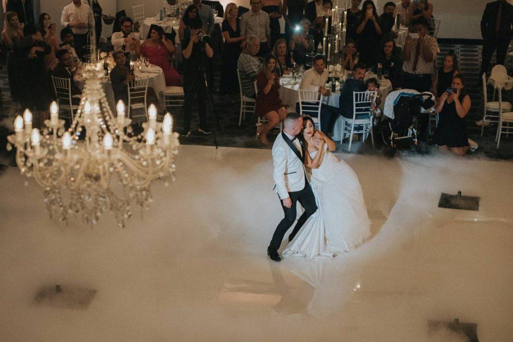 cool pgotography wedding couple on dance floor