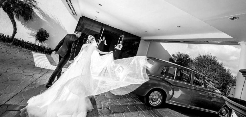 Couple by wedding car