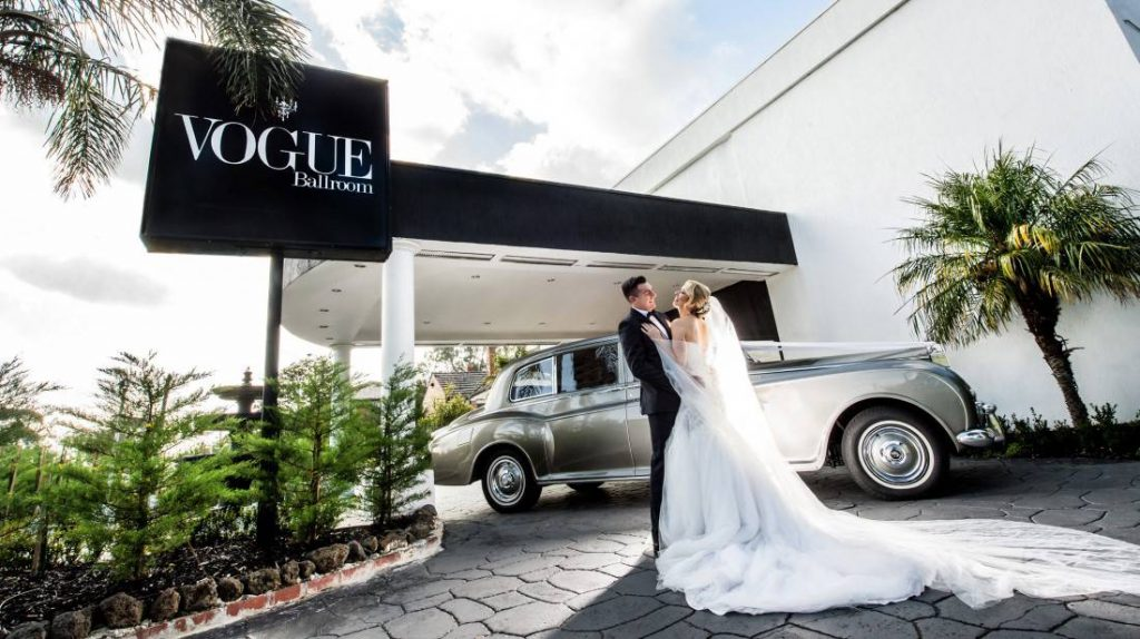 married couple by Luxurious car