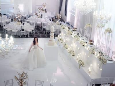 bride standing on white ballroom