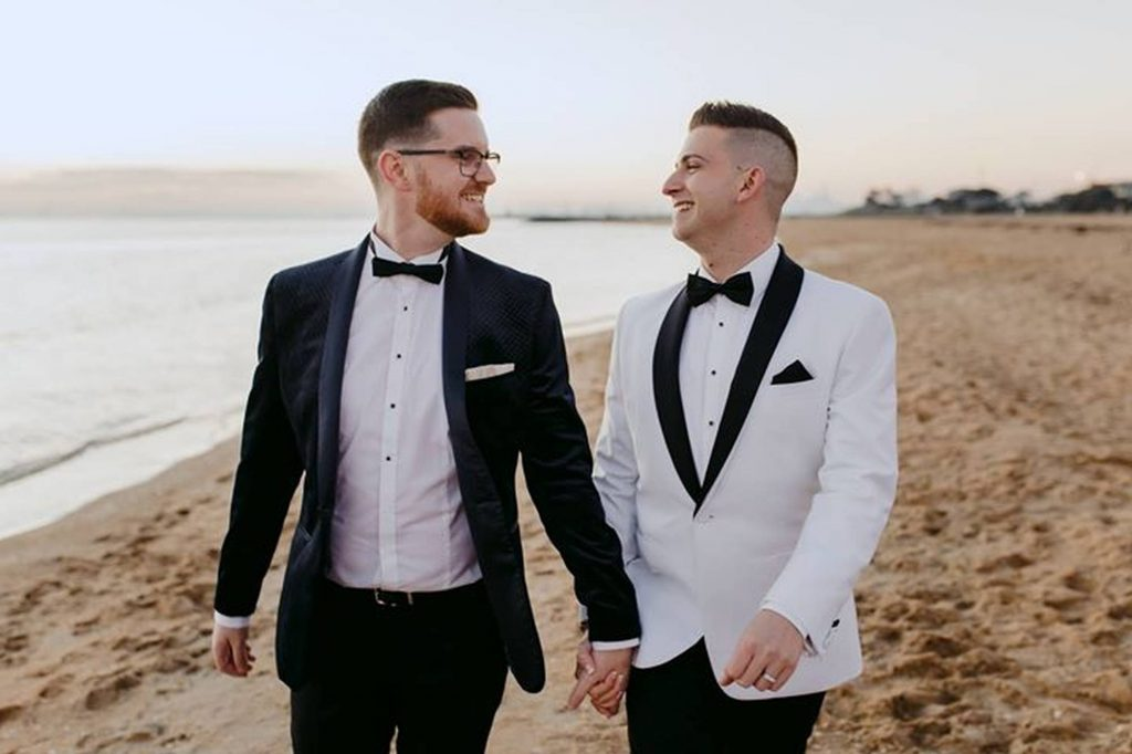 same sex couple on beach wedding
